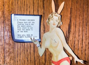 3D6936CE00000578-4239528-A_topless_Playboy_Bunny_picture_holds_up_a_note_asking_guests_an-m-11_1487515665480