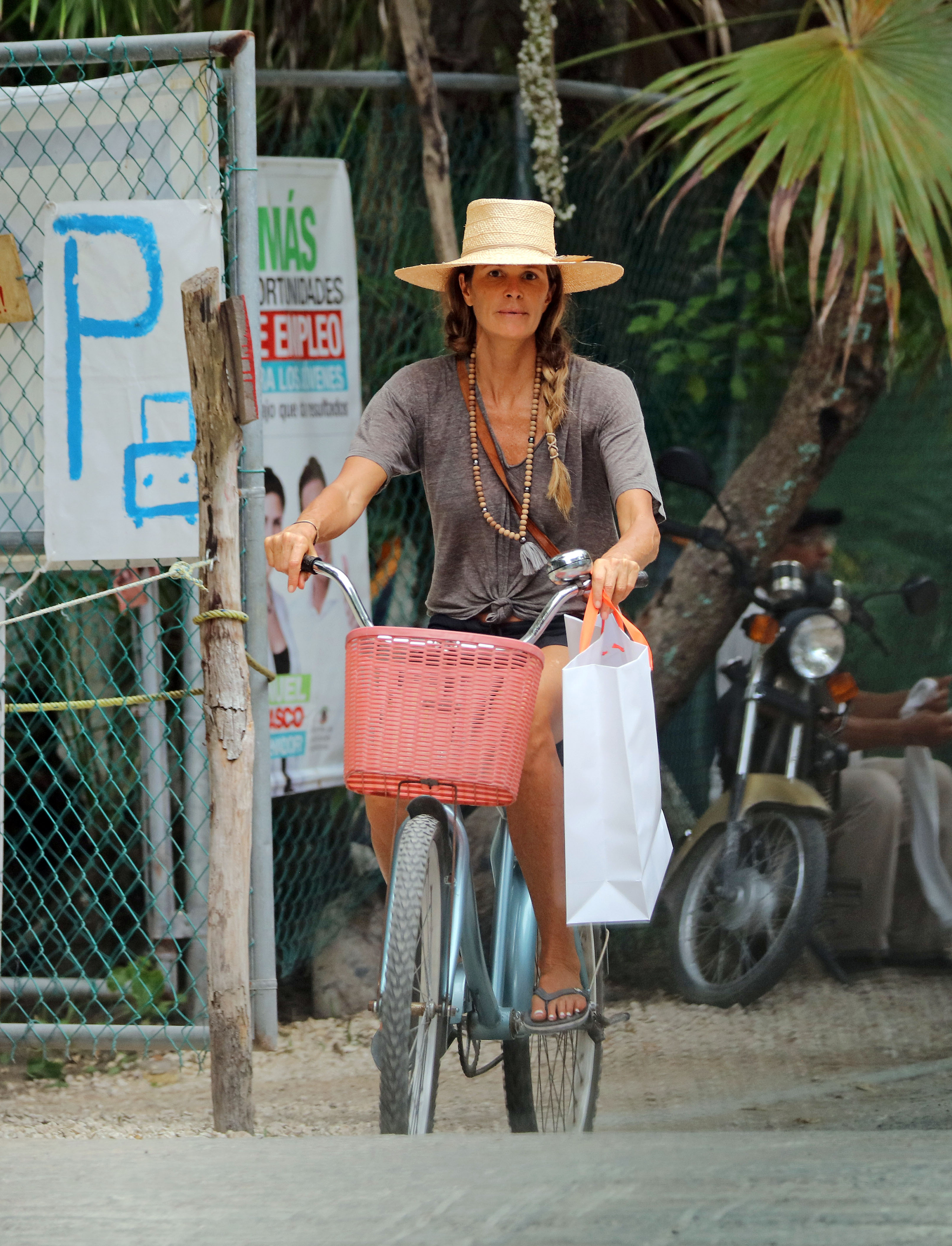 EXCLUSIVE: Elle Macpherson is seen enjoying a bike ride as she enjoys Holidays in Tulum Mexico.