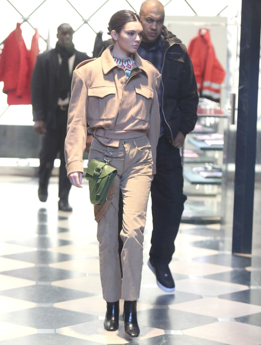 New York, NY  - Kendall Jenner changes her outfit as she steps out for some shopping therapy in Soho. Kendall looks great in a matching tan ensemble which she paired with a clip on green leather bag, black leather boots, and sunglasses. Pictured: Kendall Jenner BACKGRID USA 8 FEBRUARY 2018  USA: +1 310 798 9111 / usasales@backgrid.com UK: +44 208 344 2007 / uksales@backgrid.com *UK Clients - Pictures Containing Children Please Pixelate Face Prior To Publication*